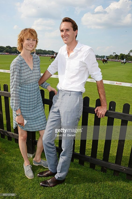 Edie Campbell (L) and Otis Ferry attend Audi International at Guards Polo Club, near Windsor, to support England as it faces Argentina for the Coronation Cup on July 26, 2014 in Egham, England.