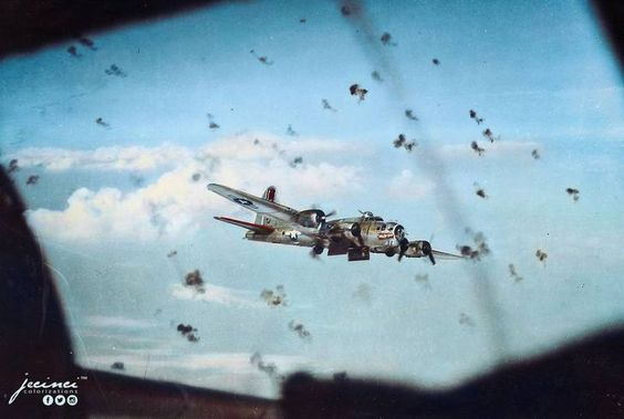 "B-17G Flying Fortress ""Lady be Good"" -J of 728 Bomb Squadron, 452 Bomb Group dodging flak (exploding anti aircraft shells) on a mission over the Ludwigshafen Industrial Oil Refinery in western Germany on September 21 1944.  The 452nd Bomb Group flew B-17 Flying Fortresses from Deopham Green, Norfolk, from January 1944. The air crews hit strategic sites in Germany but also supported the movement of ground forces across Europe after D-Day. On 6 June 1944 itself, the Group bombed coastal…"