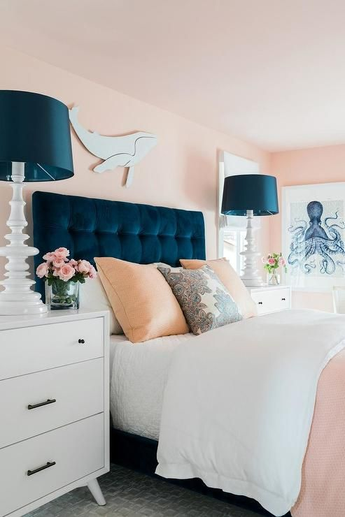 A White Whale Art Piece Hangs From A Pink Wall Above A Blue Velvet Tufted Headboard Accenting A Bed Com Luxurious Bedrooms Bedroom Design Luxury Bedroom Design