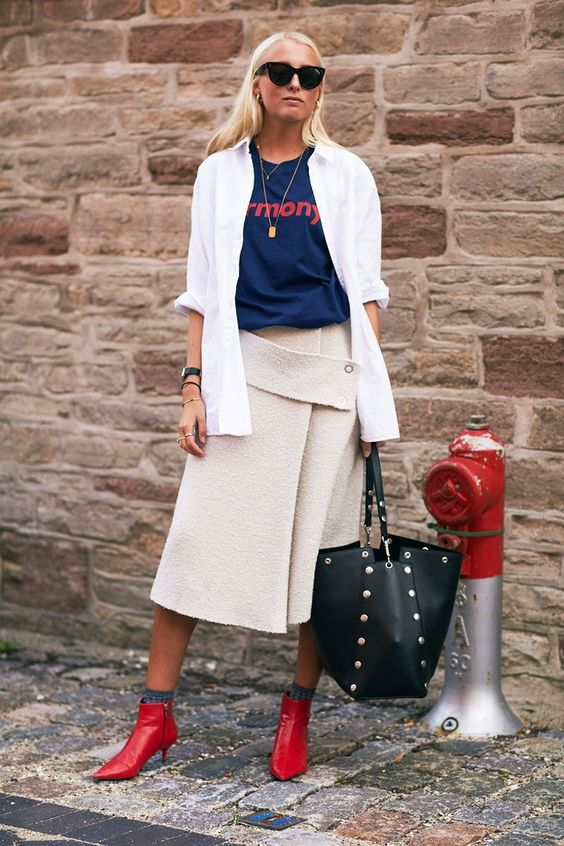 Copenhagen Fashion Week Street Style: red booties, navy graphic tshirt, creme colored midi skirt, and a white button down.