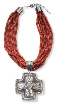 Bold by nature. Vibrant orange branch coral beads in a lavish cluster of seven strands. Grand, hand-stamped sterling silver cross, handmade by Navajo artist Vincent Platero. Made in the USA.:
