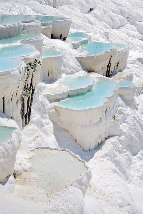 """Pamukkale, meaning """"cotton castle"""" in Turkish, is a natural site in Denizli Province in southwestern Turkey. The city contains hot springs and travertines, terraces of carbonate minerals left by the flowing water. #royalcaribbean"""