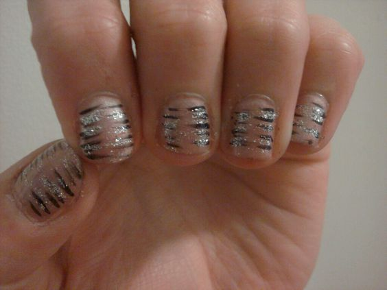 My new nails, I did these myself, took inspiration from my nail stylist.  Harmony Gelish polish set, plus black and silver sparkle accessory...took all of 20 mins for a full polish