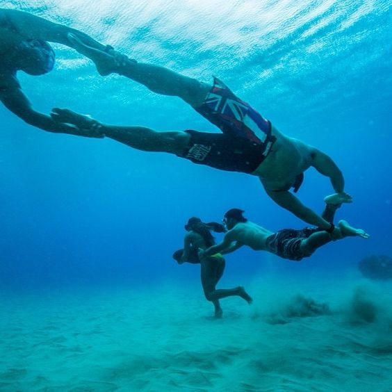"Photo by @paulnicklen #onassignment for @natgeo in #Hawaii.  The ""train"" is a technique invented by #hawaiian watermen to train lifeguards. The first runner, waterwoman @haakeaulana is carrying a 50 lb rock and towing 3 other lifeguards, including her legendary father #Briankeaulana and @samkapoi. With @cristinamittermeier in #makahabeach , #thephotosociety."
