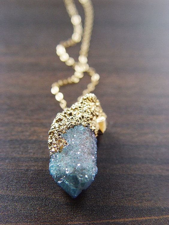 Featuring a single beautiful natural aqua aura spirit quartz drusy mineral gemstones which was handcrafted into a 14k gold filled bezel set pendant piece.  The stone has a pretty natural sparkle.    This necklace highlights the beautiful elements of this arresting stone. The stone measures approx.1 long.    This stone is a remarkable feature of nature and hangs from 18 14k gold filled chain. (Chain can be changed to any desired length for an upgrade fee).    This piece is a limited edition…