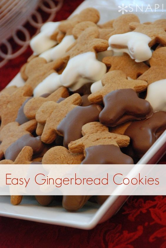 I kind of hate decorating gingerbread cookies. LOVE the look of these dipped in chocolate- simple and delicious!