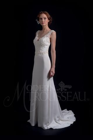 Modern Trousseau Flynn is a simple lace sheath gown. It features exquisite French three-dimensional lace bodice over a fit to flare skirt with a chapel train. This gown came from a designer bridal boutique and is in good condition. Modern Trousseau Flynn is Ivory and a size 12.