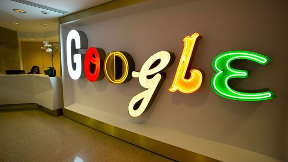 In this Monday, Oct. 28, 2013 photo, Google's trademark name lights up