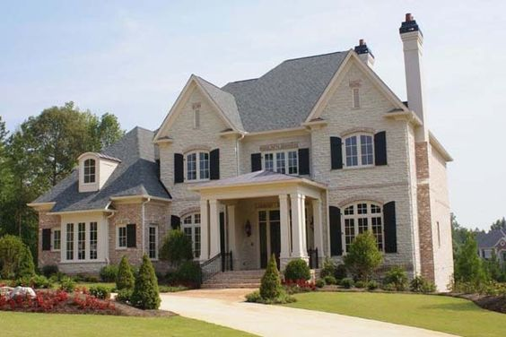 Brick and stone house exteriors brick and stone homes for Mixing brick and stone