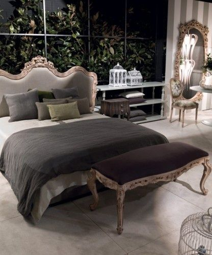 Neutral does not have to be boring. This gray bedroom is so calming, chic, and warm feeling. I love the play of textures.