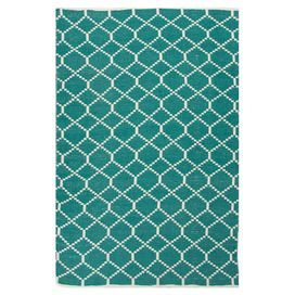 Indoor/outdoor rug with a trellis motif.   Product: RugConstruction Material: 100% PolyesterColor: Turquoise and ivoryFeatures:  ReversibleEasy careDurable Suitable for indoor and outdoor use Note: Please be aware that actual colors may vary from those shown on your screen. Accent rugs may also not show the entire pattern that the corresponding area rugs have.Cleaning and Care: Vacuum regularly