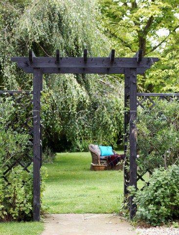 ARCH WAYS IN MY garden View through wooden archway to