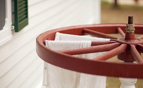 revolving-small wagon wheel towel bar on an old spindle