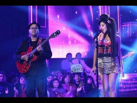Robin Banerjee (former Amy Winehouse guitarist) and Any Rodriguez, Peruvian interpreter of Amy.. during a TV performance on the program 'Yo Soy' on Peruvian Television. Related