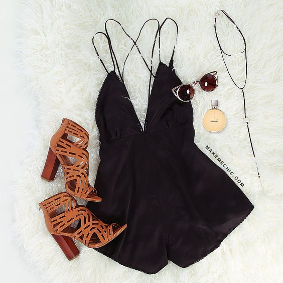 "Show off your seductive side with the Cut Out Silky Romper! Features criss cross spaghetti straps and lace trim. Measures 25"" from shoulder to bottom hem. Pair with layered necklaces and an oversized clutch purse! Modeled in a size S. Modeled in a size S. Model's Profile: Height 5'8"" Bust 34"", Waist 23"", Hips 35"".:"
