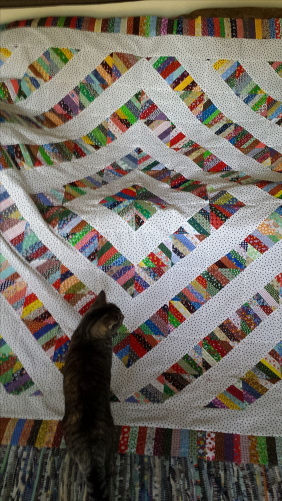 String quilt blocks laid out in barn-raising pattern.  Fun to make!: