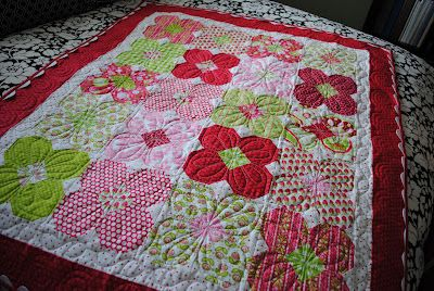 "Snowball flowers.  Just like a snowball block but only sew squares on three corners, two from background color and one from ""center"" color.:"