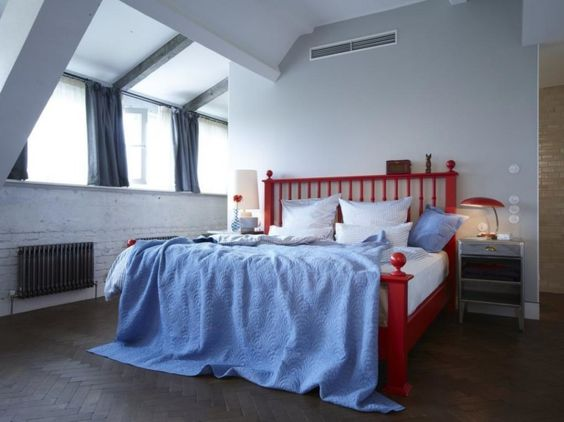 Elegant Blue Bedroom Interior Design : Small Attic Blue Bedroom Interior Design With Blue Duvet Cover As Well Red Wooden Bed Frame Along With Dark Wooden Floor And Elegant Lamps Desk The Bedside