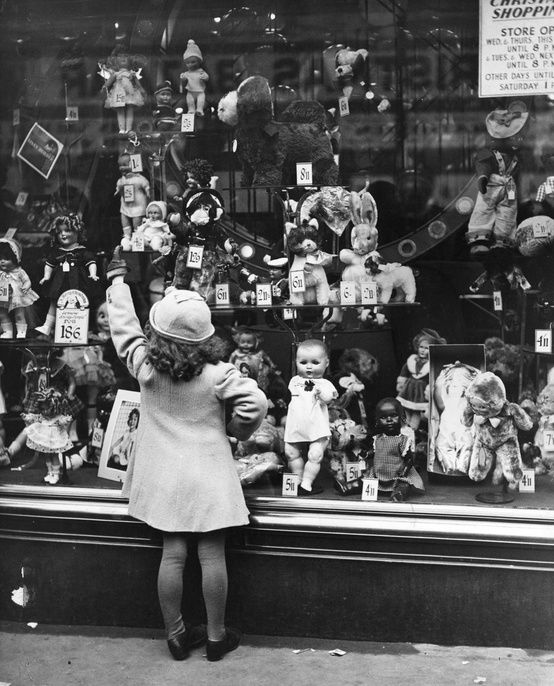 Vintage Christmas Photo - Sweet Child Looking in Department Store Window. The 40's or 50's display is similar to the scene in A Christmas Story: