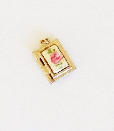 This is a beautiful vintage guilloche book locket! It appears to be gold filled but no mark that I can see. It is 1/2L x 3/8 W. It snaps closed