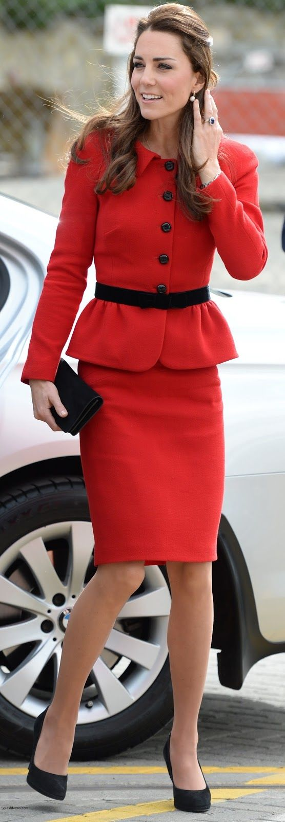 Christchurch, New Zealand, April 14, 2014-The Duchess of Cambridge repeated a Luisa Spangoli red skirt suit she first wore on a visit to St. Andrews University, teamed with black accessories to honor the colors of Christchurch
