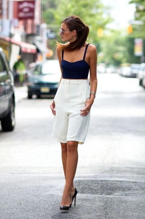 We Wore What in long white shorts, a tank, and heels: