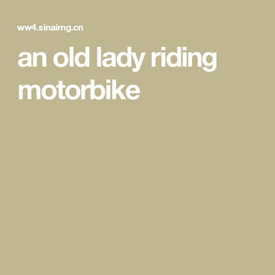 an old lady riding motorbike