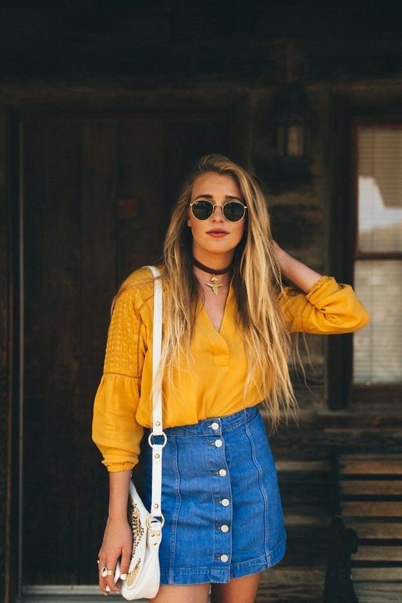 Mustard blouse + button up skirt.