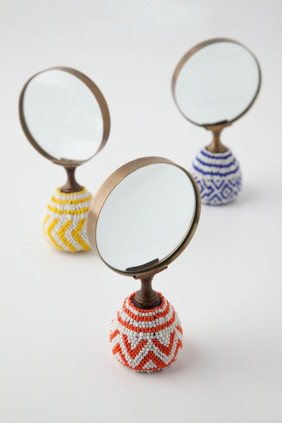 Spend a day really noticing and looking closer at the world around us. Great activity for kids and their parents.  (Beaded Congo Magnifying Glass - Anthropologie.com)