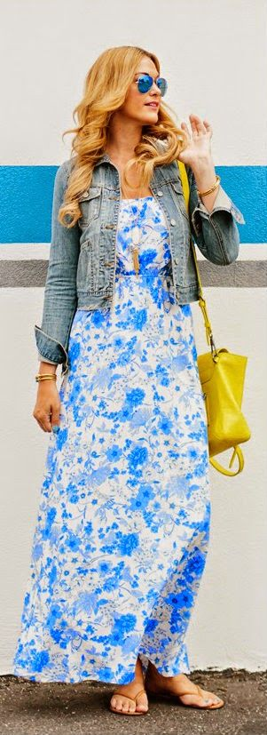 Gorgeous blue floral cute maxi dress with denim jacket and yellow leather hand bag and brown ladies simple shoes and awesome goggles the best summer street style outfits