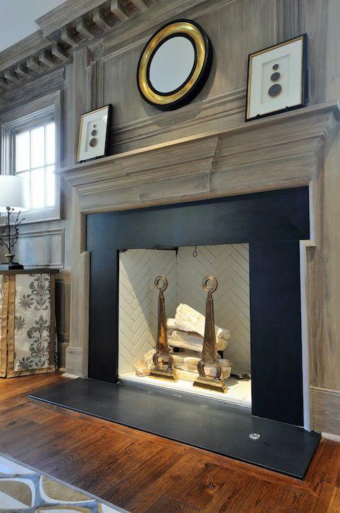 Gray Washed Millwork Black Stone Fireplace Surround