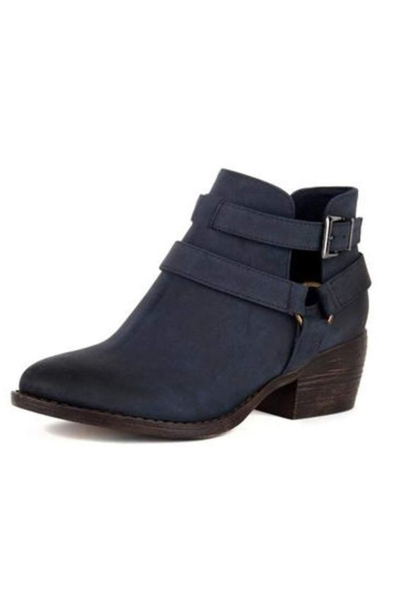 Cerulean blue faux suede booties with two straps one with a buckle and the other a circular metal detailing. Pair with ankle denim and a white sweater with a fur hooded jacket over the top.   Communal Bootie by BC Footwear. Shoes - Booties - Heeled New York