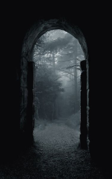 an arch through the fog