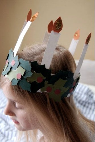 St. Lucia crafts (candle wreath crown for girls, star hat for boys) to celebrate the traditional Scandinavian holiday that focuses on bringing light into the darkness of winter, and also (in some Scandinavian countries) ushers in the Christmas season.