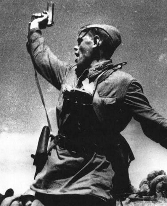 Alexey Gordeevich Yeremenko, a political officer in the Red Army during World War II, leads Soviet troops against German forces while brandishing his Tokarev sidearm.