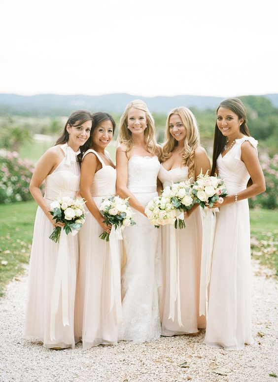 Coordinating neutrals: http://www.stylemepretty.com//2015/07/27/mix-n-match-bridesmaids-dresses-youll-love/