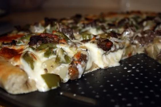Philly cheesesteak pizza. OMG to die for. BEST pizza we ever made or had. Trick is provolone and baste crust with garlic and olive oil.