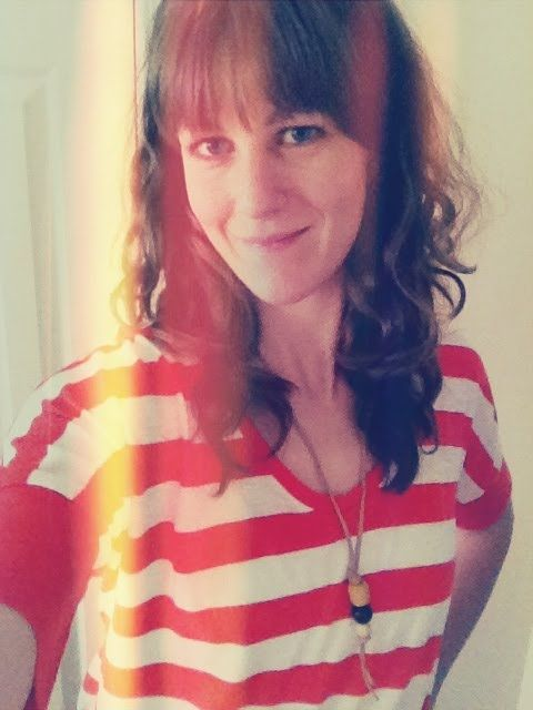 Wooden bead necklace--so summery! (And hair inspiration . . . love the bangs. Maybe I should get some like that . . . ?)