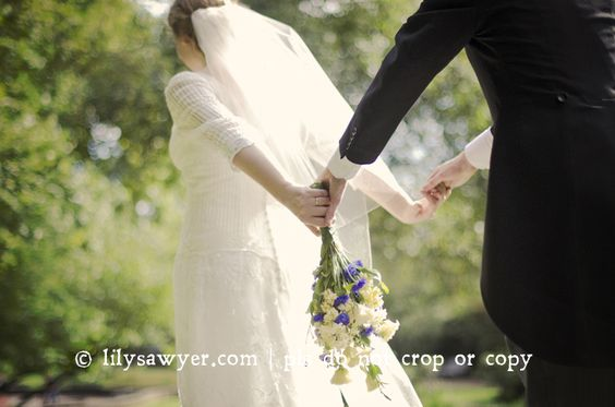 wedding bride and groom holding hands