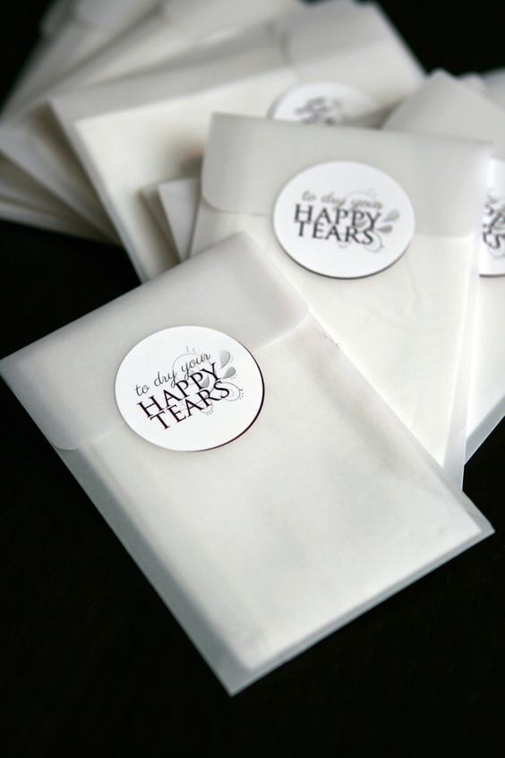 """DIY """"tears of joy"""" tissue packs for wedding ceremony - I used a bird seed package template on vellum paper for the pocket and designed stickers (printed with Vista Print)"""