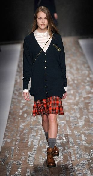 Love the plaid skirt and the socks with the boots.