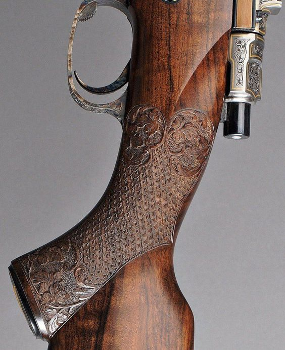 Amazing carved grip on m98 bolt-action rifle.