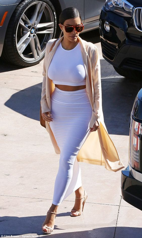 Watching that waist: Kim Kardashian allowed a glimpse of her toned midriff in a tight two-piece ensemble as she arrived at Geoffrey's in Malibu for Bruce Jenner's birthday celebration on Wednesday
