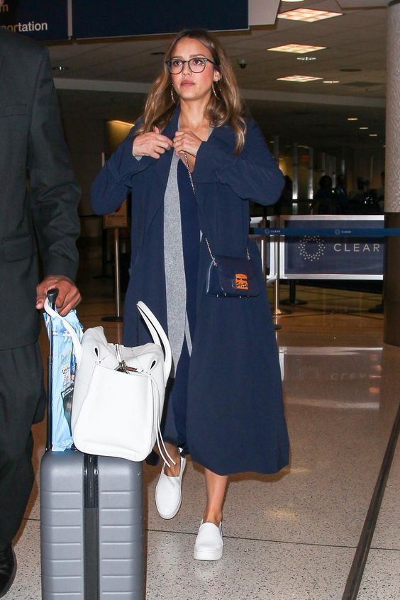 Jessica Alba wearing Furla Metropolis Mini Satchel Bag in Navy, Vince Warren Leather Sneakers, Away Carry-on Luggage and Grana V Neck Slip Dress
