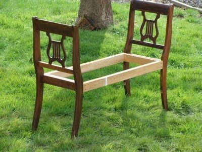 No directions, but the pic speaks for itself. Take two old chairs and make a bench. Maybe add a top of plywood or even just slats, and then a cushion. Repaint and GORGEOUS!