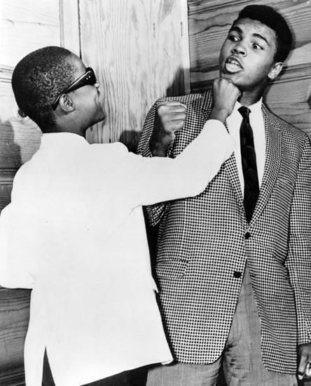 13yr old #StevieWonder goofing around with #MuhammadAli at The Apollo, Harlem, 1963!