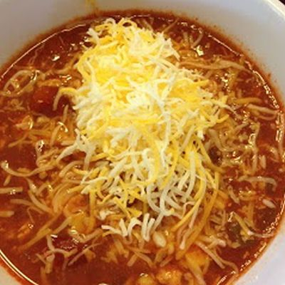 Chicken Fiesta Soup - crockpot recipe 4 bonesless skinless chicken breasts (cooked and shredded) 1 can corn 3 10oz cans red enchilada sauce  8oz chopped green chiles 1 can diced tomatoes (drained) 1 14.5oz can chicken broth 1 cup chopped onion 1 tsp ground cumin 1 tsp chili powder 1 tsp black pepper