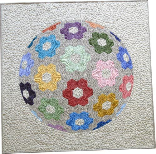 Flower Ball quilt and pattern by Geta Grama, featuring the Fusions collection. How can one person contain SO. much. talent?