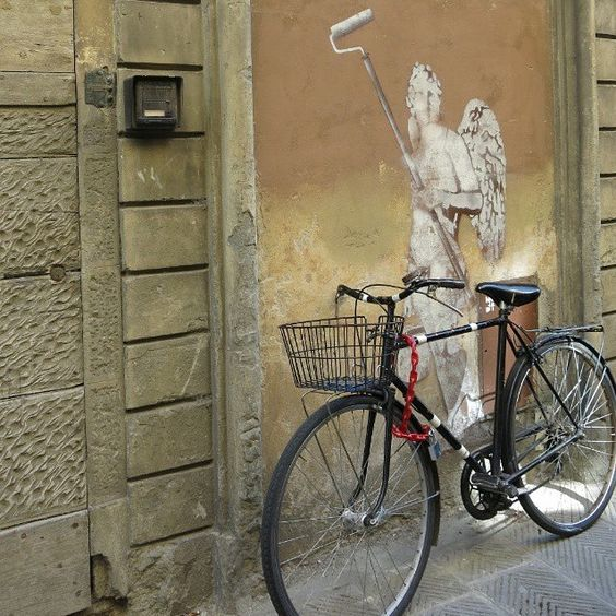 The Angel on my Bike by @kko755 .  Another #Florence #Bike ! Today it looks like our instagrammer friends are all posting from Italy. Join the challenge and post your bike in a cityscape with the hashtag #CityBikes and tagging @uniplaces. We will repost your photo!