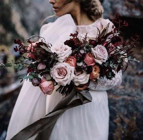 Wedding Inspiration | LOVE! Beautiful Peach, Light Pink + Deep Red flowers empower this bouquet. #differentflowersforweddings